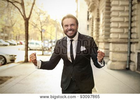 Successful businessman in jubilant attitude