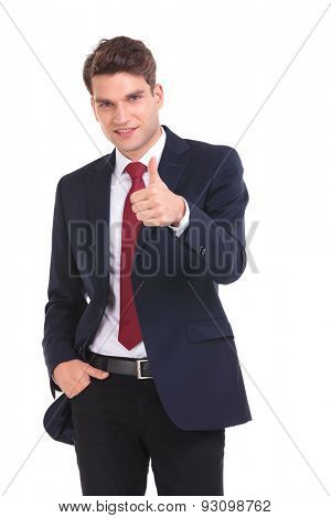 Portrait of a young business man holding his hand in pocket while showing the thumbs up gesture.