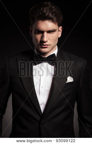 Portrait of a handsome elegant man wearing a black tux.