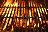 stock photo of flame  - Flaming Empty BBQ Charcoal Grill Background Texture - JPG