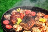 image of baby back ribs  - Mixed Meat And Vegetables On The Hot BBQ Charcoal Grill - JPG