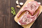 picture of pork chop  - Fresh Raw Pork Chops on wooden background - JPG