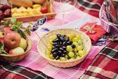 foto of nic  - Beautiful grapes with different food lies in the basket on the plaid - JPG
