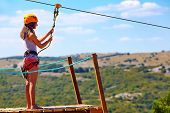 picture of descending  - young woman are ready to descend on zipline in mountain extreme sport - JPG