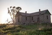 stock photo of prairie  - An abandoned homestead deteriorates over time in an open prairie  - JPG
