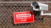 stock photo of warning-signs  - Security surveillance camera on chain - JPG