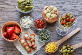 picture of pickled vegetables  - Pickled Vegetables On The Wooden Background Close Up - JPG