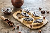 picture of baguette  - Slices Of Baguette With Chocolate Cream On The Wooden Board - JPG