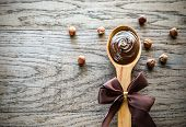 picture of chocolate spoon  - Wooden Spoon Of Chocolate Cream With Hazelnuts - JPG
