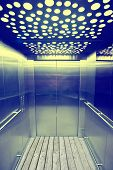 foto of elevator  - view from inside the elevator. Steel walls and wooden floor ** Note: Visible grain at 100%, best at smaller sizes - JPG