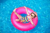 picture of rings  - Child in swimming pool - JPG