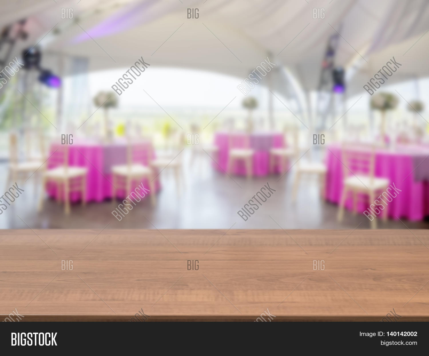 dark wooden empty table in front of blurred restaurant interior