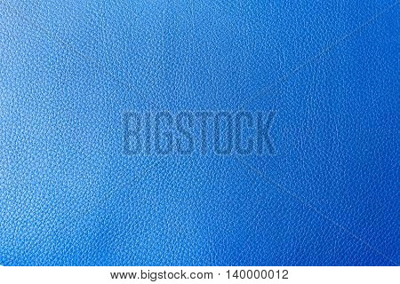 The leather texture background in the light-blue tone