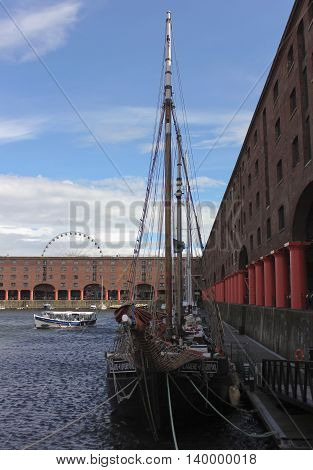 LIVERPOOL, ENGLAND, JULY 2. Albert Dock on July 2, 2016, in Liverpool, England. Liverpool landmarks include Albert Dock the Big Wheel ferris wheel Skylark Boat Trips and the Tate Art Museum.