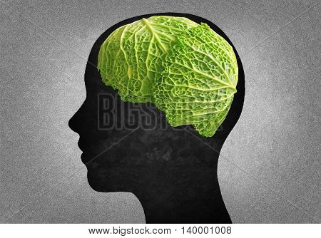 Silhouette of human head with a cabbage instead of the brain