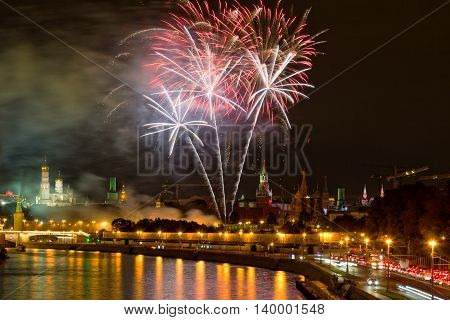 Fireworks over the Moscow Kremlin at night. View of the Moscow River Russia