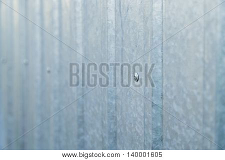 Old blue galvanized metal sheet, background wall