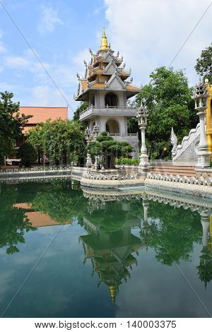 Buu Long temple reflection into the pond in Ho Chi Minh city vietnam