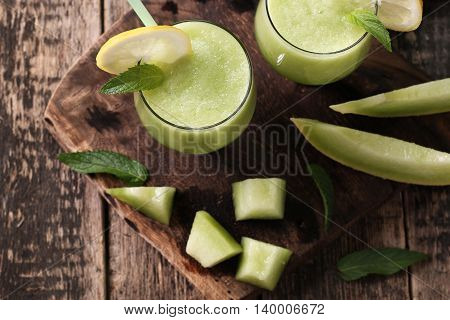 Fresh Melon Smoothie In The Glass On The Wooden Table