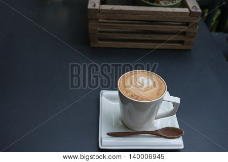 hot fresh coffee in white cup and wooden basket on black table and white saucer cappuccino coffee mocha coffee espresso coffee latte coffee