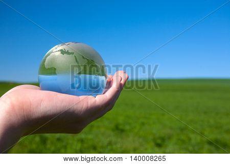 Glass earth in human hand