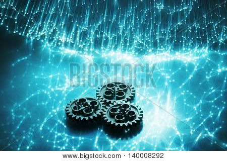 Fiber optics and gear High tech technology color background
