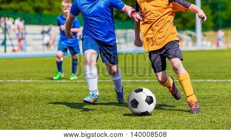 Children Playing Soccer Football Match. Sport Soccer Tournament for Youth Teams.