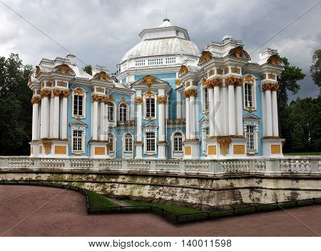 PUSHKIN RUSSIA - JULY 19 2016: View of the famous Hermitage pavilion in the Catherine Park at Tsarskoye Selo (Pushkin town) not far from Saint-Petersburg July 19 2016.