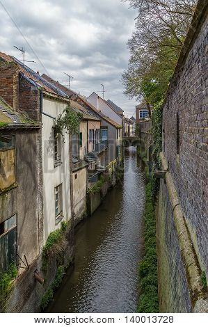view of canal in Amiens city center near cathedral France