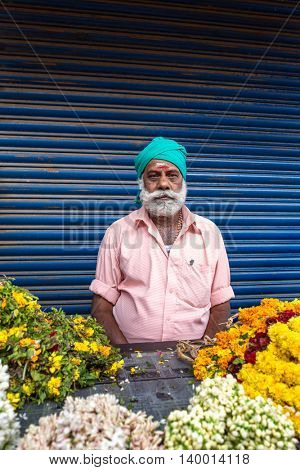 Cochin, India - January 5, 2016: Unidentified sikh man sell flowers on streets of Cochin, India