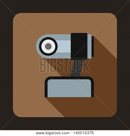 Webcam icon in flat style on a coffee background