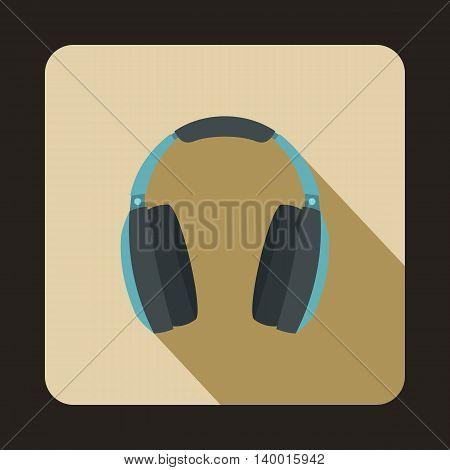 Headphones icon in flat style on a beige background