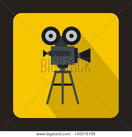 Old movie camera with reel icon in flat style on a yellow background