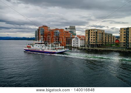 Stavanger, Norway -September 18, 2011: Cityscape of Stavanger down town with ferry on foreground.