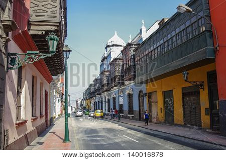 Lima, Petu -December 31, 2013: Street view of Lima old town with traditional colorful houses and wooden balcony.