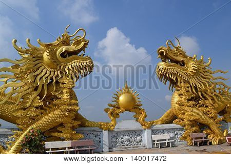 two big statue of golden dragon at Buddhist Chau Thoi temple Binh Duong Vietnam