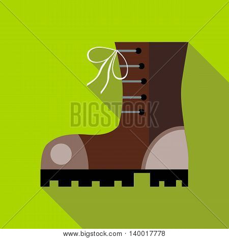 Hiking boot icon in flat style on a green background