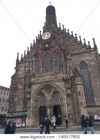 Germany, October 18, 2015, Nuremberg, Bavaria,  Frauenkirche Chatedral Entrance with an old clock