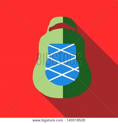 Green backpack icon in flat style on a red background