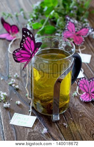 Decoration Paper Butterfly In A Glass Of Mint Tea. Children's Art Project, A Craft For Children.