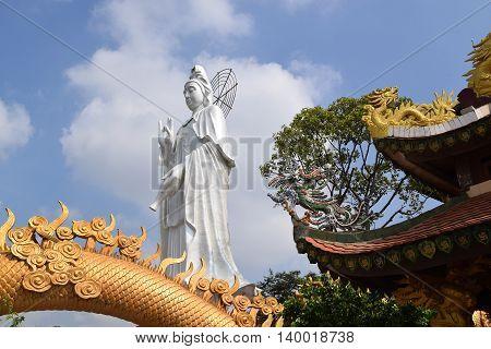big statue of Bodhisattva at Buddhist Chau Thoi temple Binh Duong Vietnam