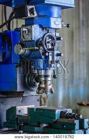 Detail of Milling machine in factory workshop.
