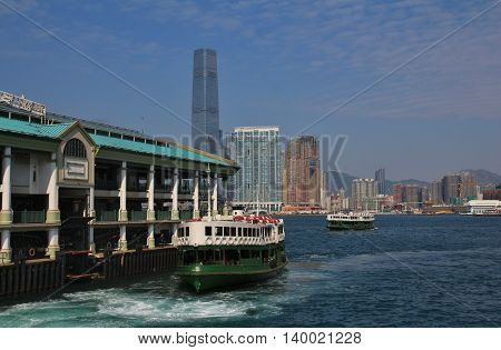 Old ferry and skyscraper in Hong Kong.
