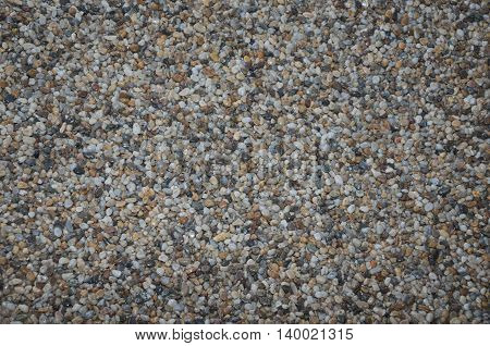 Natural photo texture with lots of small stone material. deatil photo of ground with rocks.