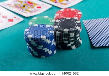 Stacks of poker chips with cards. Quality studio shot.