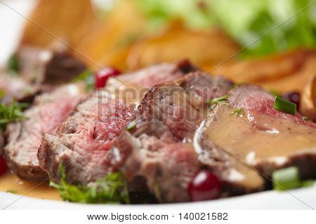 Tasty roasted pork meat with potatoes
