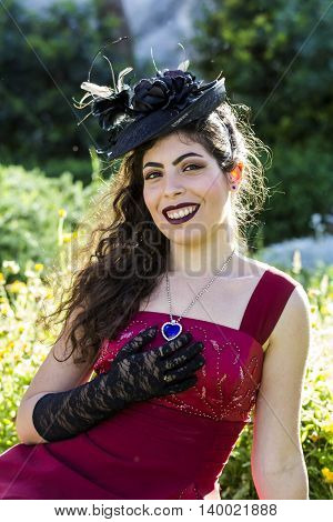 CAGLIARI, ITALY - May 29, 2016: Sunday at La Grande Jatte VIII Ed. At the Public Gardens - - portrait of a beautiful girl in Victorian costumes