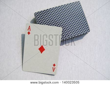 Diamond ace and card deck isolated on white light gray background