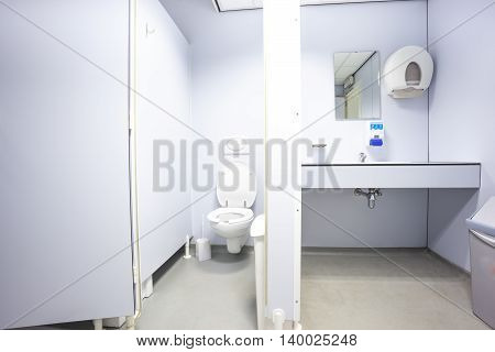 In an public building are womans toilets with sinks