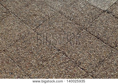 Paving stone stone background in the light of the evening sun.